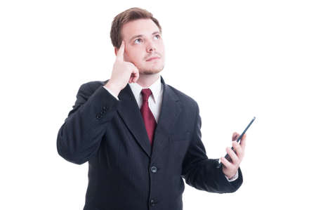 banker: Smart banker holding tablet and thinking or wondering about financial results Stock Photo