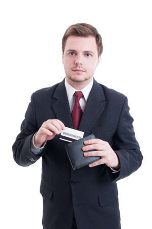 secure payment: Suited man pulling credit card from wallet as secure payment concept isolated on white