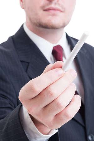 unlit: Elegant suited anonymous man offering an unlit cigarette concept Stock Photo