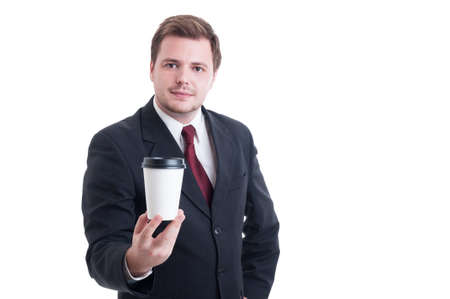 to go cup: Businessman presenting a coffee to go cup isolated on white