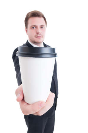 to go cup: Business man holding a coffee to go cup with selective focus on the container