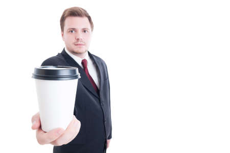 to go cup: Businessman holds and offer a coffee to go cup isolated on white Stock Photo