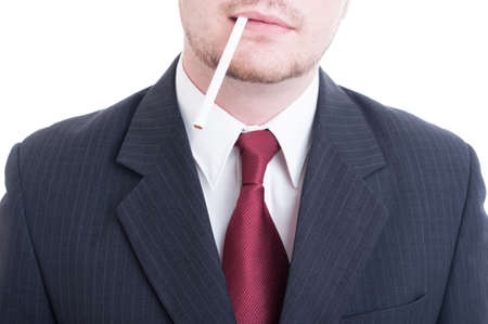 unlit: Businessman holding an unlit cigarette between lips waiting the break concept isolated on white