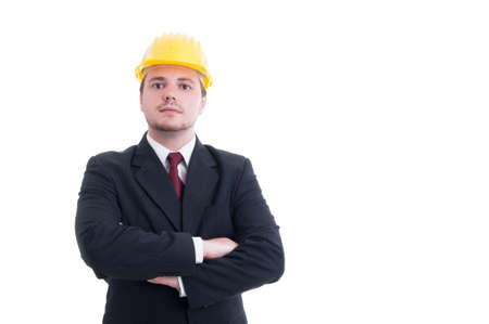 foreman: Confident and successful contractor, foreman, or architect with arms crossed wearing a yellow hardhat