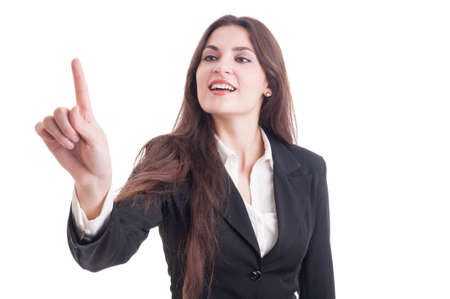 corporate women: Young business woman touching transparent screen with index finger.White copy space and advertising area available Stock Photo