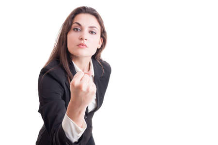 aggresive: Aggressive business woman, leader or bossy manager showing fist isolated on white background