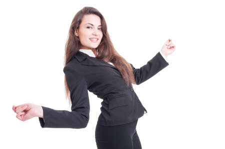 businesswoman suit: Happy young business woman dancing excited and enthusiastic isolated on white background