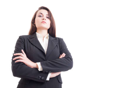 area sexy: Hero shot of young confident business woman with arms crossed looking down isolated on white advertising and copy space