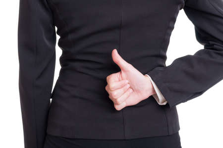 thumbup: Business woman hand showing like or thumbup gesture behind back on white background