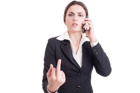 bossy: Arrogant and bossy business woman showing obscene insulting middle finger while having a phone conversation