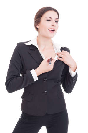 kinky: Sexy and kinky business woman writing her skin with marker while winking to the camera isolated on white background Stock Photo