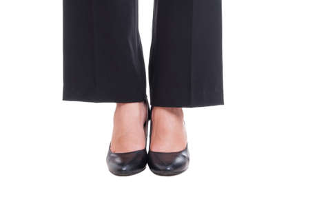 foot model: Close-up of business woman feet wearing black shoes standing together isolated on white background