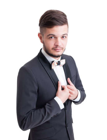 evening wear: Handsome male model wearing tuxedo jacket and colored bow tie custom made. Fashionable man evening wear concept Stock Photo