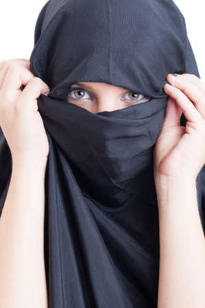 burqa: Beautiful muslim woman wearing burka on white background
