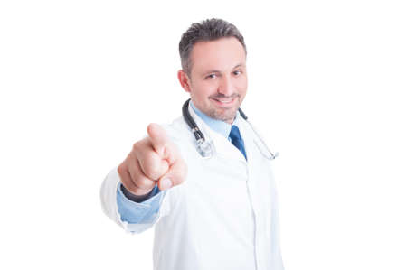 handsome doctor: Handsome young doctor pointing finger at the camera or you smiling isolated on white background Stock Photo