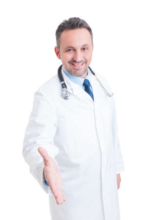 Friendly smiling doctor or medic offering handshake as deal and partnership gesture concept isolated on white background Reklamní fotografie