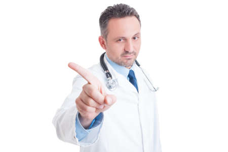 Doctor or medic saying no and making refuse gesture with index finger looking into camera isolated on white background Foto de archivo