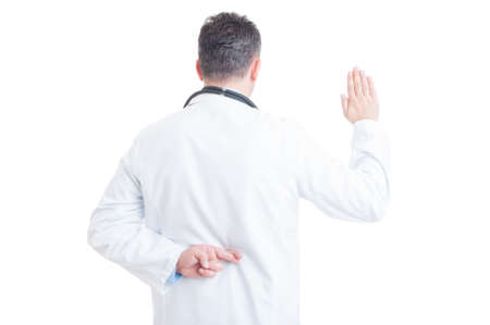 cheater: Anonymous doctor or medic making false oath with crossed fingers behind back isolated on white background. Medical falsehood concept Stock Photo