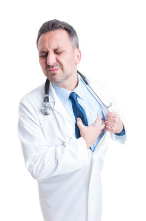 grabbing: Male doctor or medic suffering a heart attack grabbing the painful chest isolated on white background