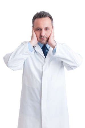 Medic or doctor covering his ears isolated on white studio background