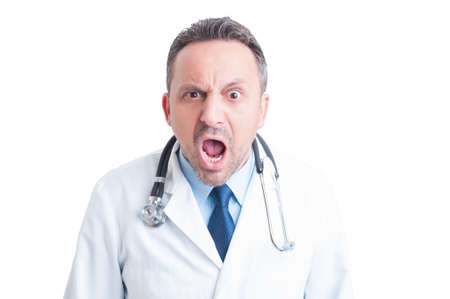 Angry medic or doctor yelling at camera as rage and fury concept Standard-Bild
