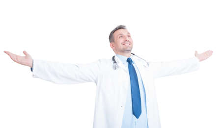 outspread: Happy doctor or medic raising hands outspread and outstretched isolated on white background