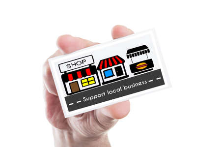 local business: Hand holding support local business concept card with stores illustration