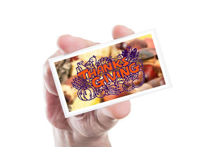 hand holding paper: Hand holding thanks giving card or greeting as traditional holiday concept Stock Photo
