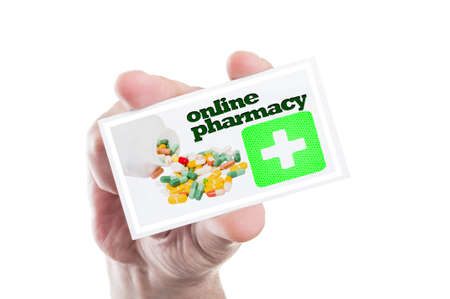 green cross: Hand holding card with online pharmacy text green cross and pills as internet drugstore website or shop