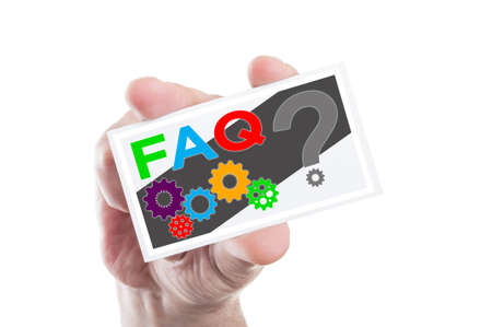 interrogation point: Hand holding FAQ or frequently asked questions card with question mark