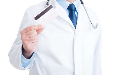 secure payment: Anonymous doctor or medic showing credit and debit  card as medical services secure payment Stock Photo