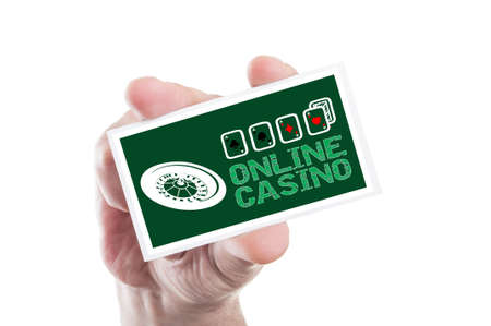 online roulette: Hand holding online casino card with roulette and four aces as internet gambling website concept Stock Photo
