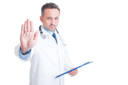 Doctor or medic making stop and stay gesture looking at the camera