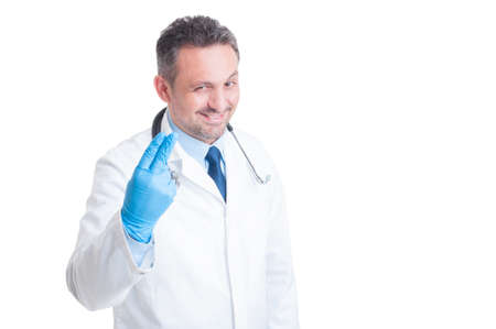 Proctologist showing two fingers with surgical latex gloves smiling isolated on white background Stock Photo