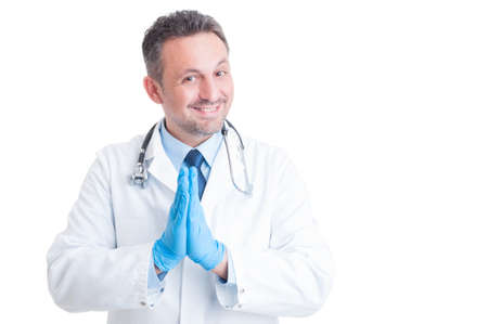 surgical gloves: Medic or doctor with surgical gloves praying and asking isolated on white background