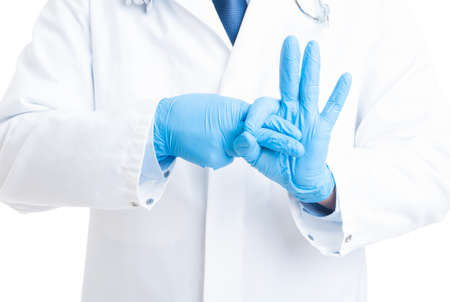Proctoligist hands making rectal exam gesture using two fingers and rubber or latex gloves