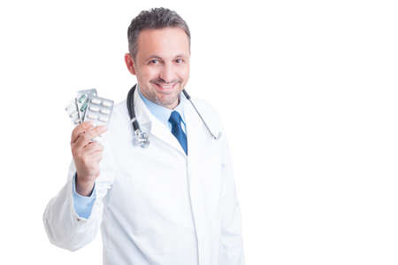 antidepressant: Doctor or medic holding and showing pill tablets isolated on white background
