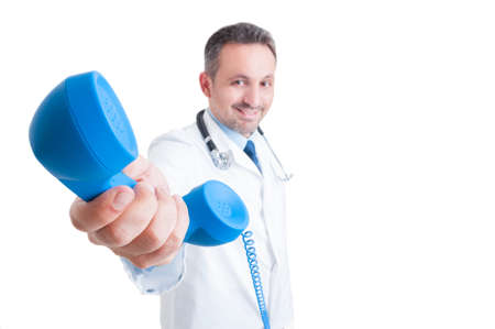medical man: Healthcare support or medical assistance concept with male doctor handing phone