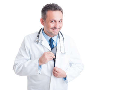 inserting: Medic or doctor inserting wallet in coat pocket smiling isolated on white background