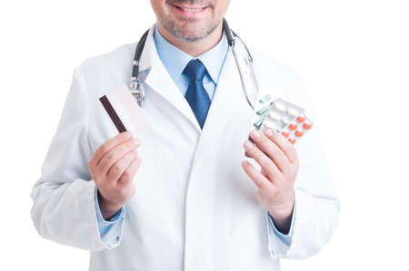 secure payment: Doctor or medic holding pills blisters and credit card as secure payment for medicine concept