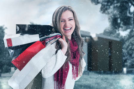 excited: Happy enthusiastic shopping woman on winter holidays snowing background