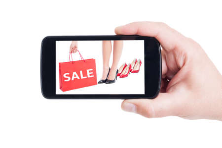 footware: Sale concept for women footware on smartphone screen or diplay