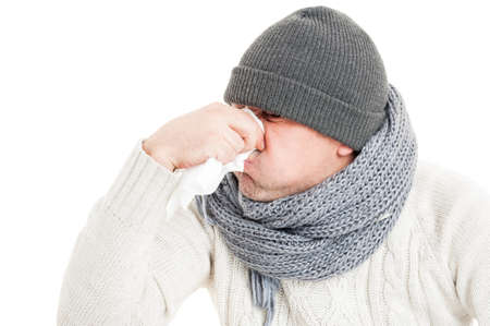 hanky: Cold man blowing his nose on paper napkin or hanky isolated on white background