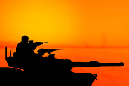 Army tank silhouette on  sunset background as terrorism concept