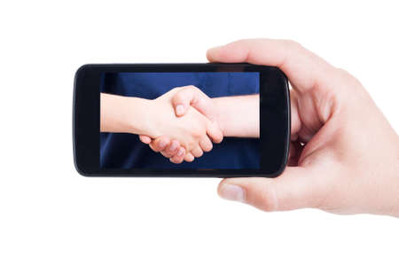 profesional: Medical handshake picture on cellphone screen as profesional doctors cooperation concept
