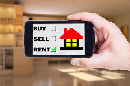 house for rent: Search a house for rent concept using mobile phone, smartphone or cellphone