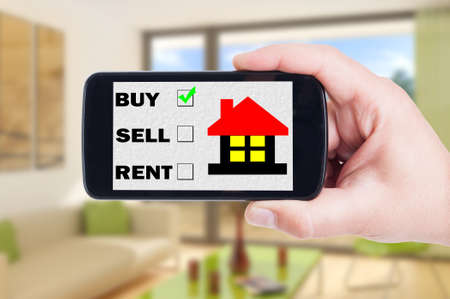 internet search: Buy a house using mobile phone, cellphone or smartphone concept with indoor background