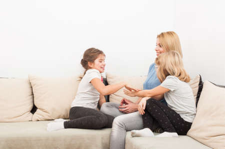single family house: Happy lifestyle concept with mother and young daughters spending time together