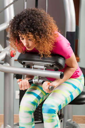 chest hair: Woman bending and doing abdominal training in the gym Stock Photo