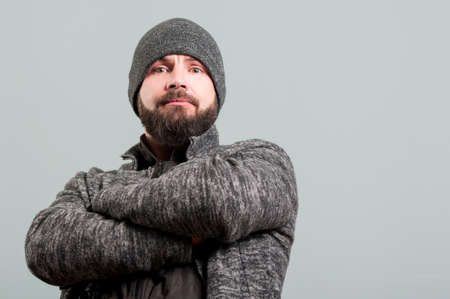 masculinity: Attractive bearded man standing with arms crossed as masculinity and trustfully concept on background studio Stock Photo